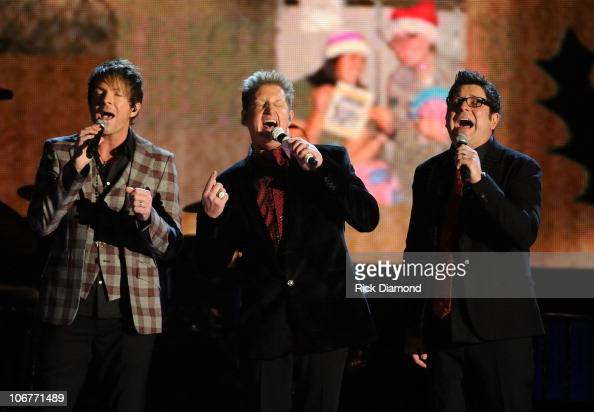 JoeDon Rooney Jay DeMarcus and Gary LeVox of Rascal Flatts onstage at the CMA Country Christmas at the Bridgestone Arena on November 11 2010 in...