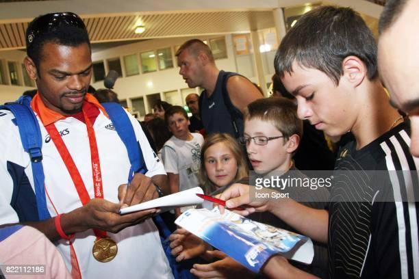 Joel ABATI Arrivee a Montpellier des medailles d'or olympique du Montpellier Handball accompagnes de Nicola KARABATIC