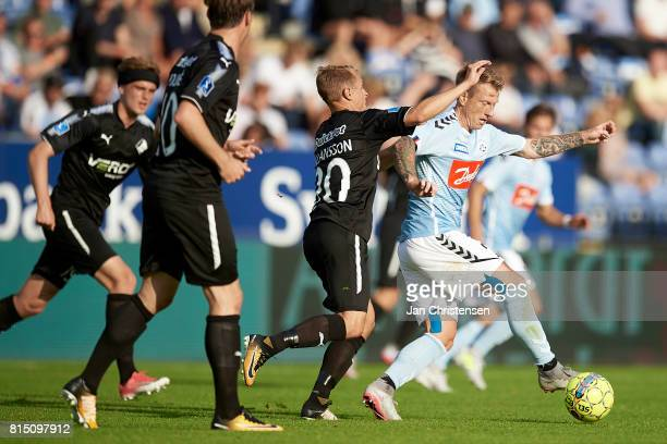 Joel Allansson of Randers FC and Niki Zimling of SonderjyskE compete for the ball during the Danish Alka Superliga match between SonderjyskE and...
