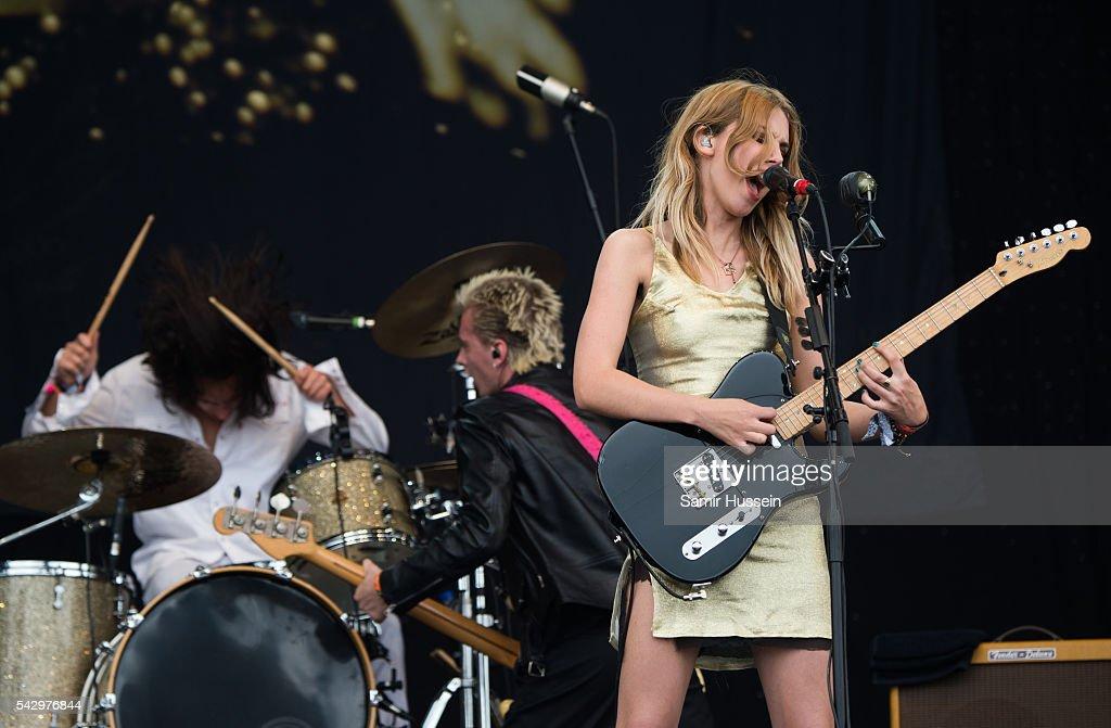 Joel Amey, Ellie Rowsell and Theo Ellis of Wolf Alice perform on the Pyramid Stage at Glastonbury Festival 2016 at Worthy Farm, Pilton on June 25, 2016 in Glastonbury, England.