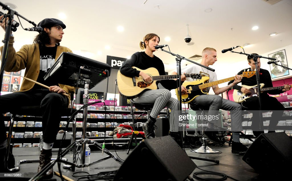 Joel Amey, Ellie Rowsell, Theo Ellis and Joff Oddie of Wolf Alice perform live in-store and meet fans, signing copies of their new album 'Visions of a Life' at HMV Manchester on October 5, 2017 in Manchester, England.