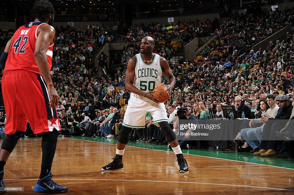Joel Anthony #50 of the Boston Celtics handles the ball against the Washington Wizards on April 16, 2014 at the TD Garden in Boston, Massachusetts.