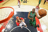 Joel Anthony of the Boston Celtics shoots against the Washington Wizards at the Verizon Center on April 2 2014 in Washington DC NOTE TO USER User...