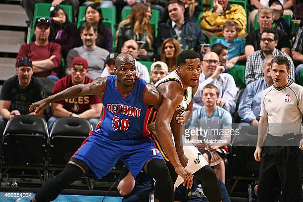 Joel Anthony of the Detroit Pistons and Derrick Favors of the Utah Jazz during the game on March 14 2015 at EnergySolutions Arena in Salt Lake City...