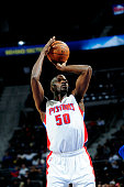 Joel Anthony of the Detroit Pistons attempts a free throw against the Orlando Magic on January 21 2015 at The Palace of Auburn Hills in Auburn Hills...