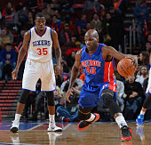 Joel Anthony of the Detroit Pistons attempts to control the ball against the Philadelphia 76ers at Wells Fargo Center on January 28 2015 in...