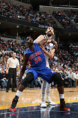 Joel Anthony of the Detroit Pistons fights for position against Marc Gasol of the Memphis Grizzlies on November 15 2014 at FedExForum in Memphis...