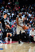 Joel Anthony of the Detroit Pistons handles the ball against the Minnesota Timberwolves on December 31 2015 at The Palace of Auburn Hills in Auburn...