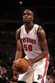 Joel Anthony of the Detroit Pistons prepares to shoot a free throw against the Philadelphia 76ers on October 23 2014 at The Palace of Auburn Hills in...