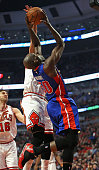 Joel Anthony of the Detroit Pistons tries to get off a shot under pressure from Joakim Noah of the Chicago Bulls at the United Center on April 3 2015...