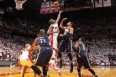 Joel Anthony of the Miami Heat and Danny Granger of the Indiana Pacers reach for the ball in Game One of the Eastern Conference Semifinals between...