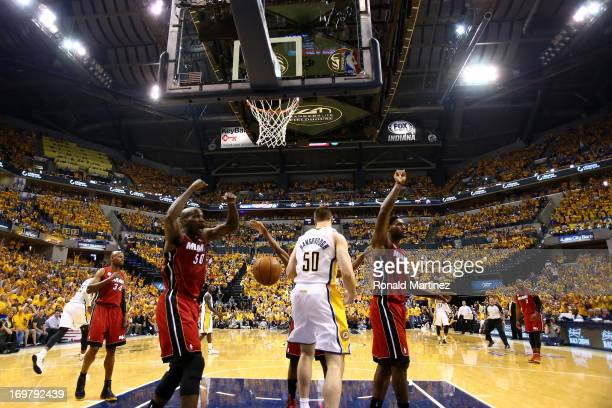 Joel Anthony of the Miami Heat and LeBron James react after a play at the basket against Tyler Hansbrough of the Indiana Pacers in Game Six of the...