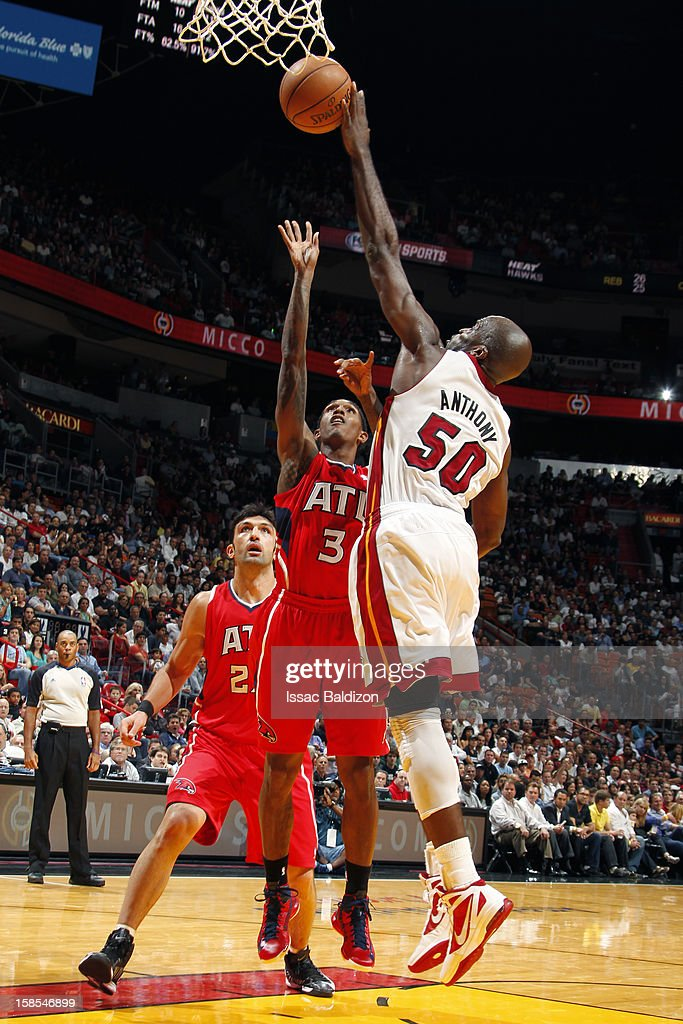 Joel Anthony #50 of the Miami Heat blocks a shot against Louis Williams #3 of the Atlanta Hawks during a game on December 10, 2012 at American Airlines Arena in Miami, Florida.