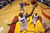 Joel Anthony of the Miami Heat controls a rebound against Dallas Mavericks in Game Six of the 2011 NBA Finals at American Airlines Arena on June 12...