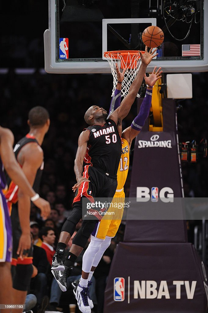 Joel Anthony #50 of the Miami Heat denies a pass to Dwight Howard #12 of the Los Angeles Lakers at Staples Center on January 15, 2013 in Los Angeles, California.