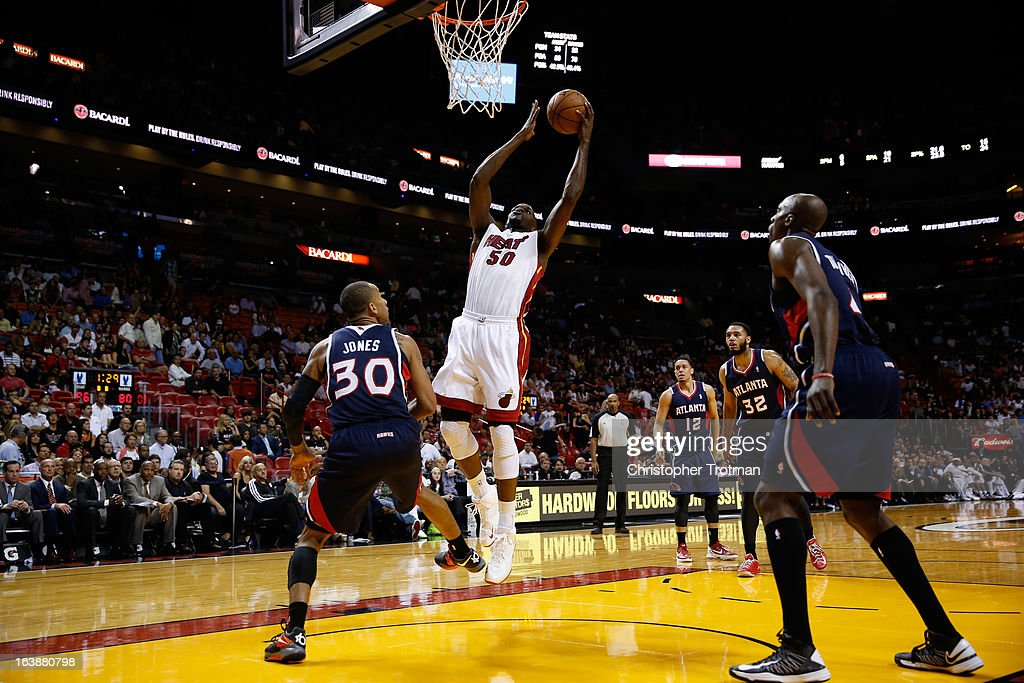 Joel Anthony #50 of the Miami Heat drives to the bastket in front of Dahntay Jones #30 of the Atlanta Hawks at American Airlines Arena on March 12, 2013 in Miami, Florida.