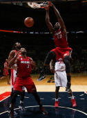 Joel Anthony of the Miami Heat dunks against Chris Singleton of the Washington Wizards during the game at the Verizon Center on December 4 2012 in...