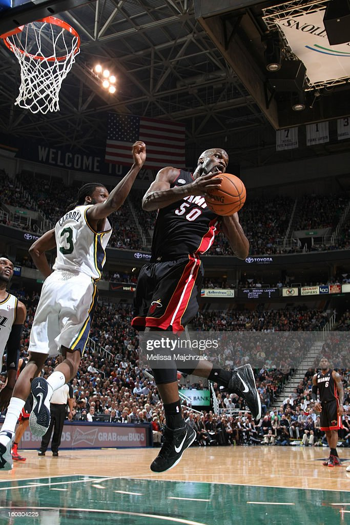 <a gi-track='captionPersonalityLinkClicked' href=/galleries/search?phrase=Joel+Anthony&family=editorial&specificpeople=4092295 ng-click='$event.stopPropagation()'>Joel Anthony</a> #50 of the Miami Heat goes to the basket against <a gi-track='captionPersonalityLinkClicked' href=/galleries/search?phrase=DeMarre+Carroll&family=editorial&specificpeople=784686 ng-click='$event.stopPropagation()'>DeMarre Carroll</a> #3 of the Utah Jazz at Energy Solutions Arena on January 14, 2013 in Salt Lake City, Utah.