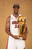 Joel Anthony of the Miami Heat poses for a portrait with the Larry O'Brien Trophy after defeating the San Antonio Spurs in Game Seven of the 2013 NBA...