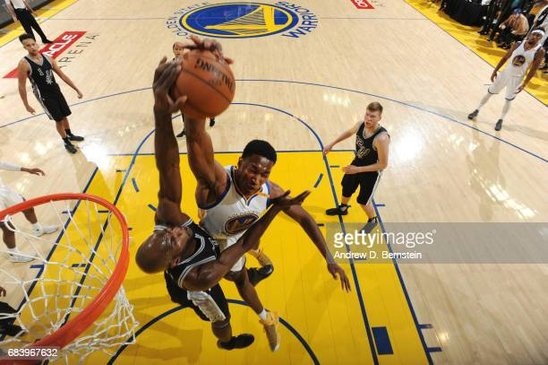 Joel Anthony of the San Antonio Spurs blocks a dunk attempt by Damian Jones of the Golden State Warriors during Game Two of the Western Conference...