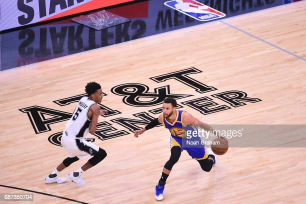 Joel Anthony of the San Antonio Spurs dribbles the ball while guarded by Dejounte Murray of the San Antonio Spurs in Game Four of the Western...