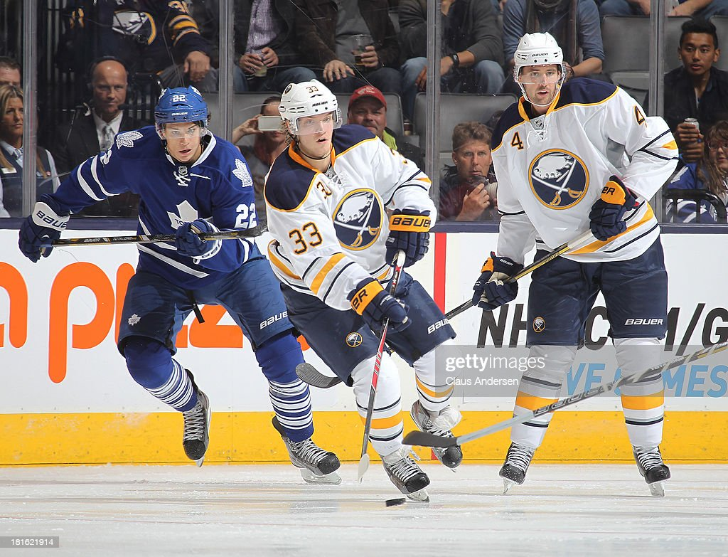 Joel Armia #33 of the Buffalo Sabres skates with the puck in a pre-season game against the Toronto Maple Leafs on Sept 22, 2013 at the Air Canada Centre in Toronto, Ontario, Canada. The Leafs defeated the Sabres 5-3.