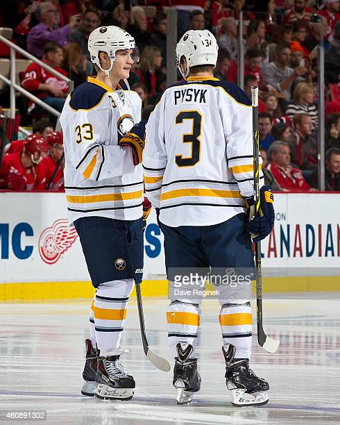 Joel Armia of the Buffalo Sabres talks to teammate Mark Pysyk before for his first NHL game against the Detroit Red Wings on December 23 2014 at Joe...
