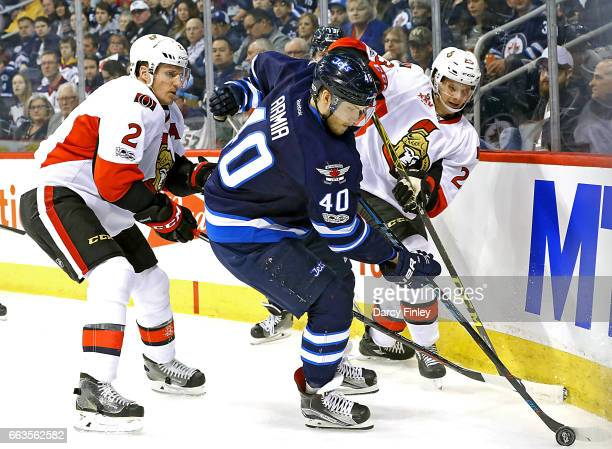 Joel Armia of the Ottawa Senators plays the puck away from Dion Phaneuf and Jryki Jokipakka of the Ottawa Senators during first period action at the...