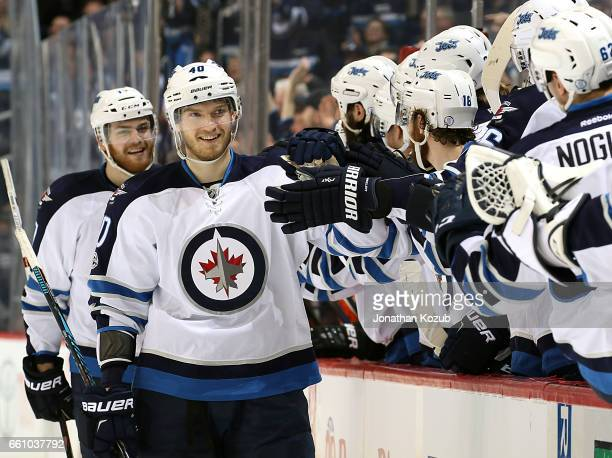 Joel Armia of the Winnipeg Jets celebrates his first period shorthanded goal against the Anaheim Ducks with teammates at the bench at the MTS Centre...