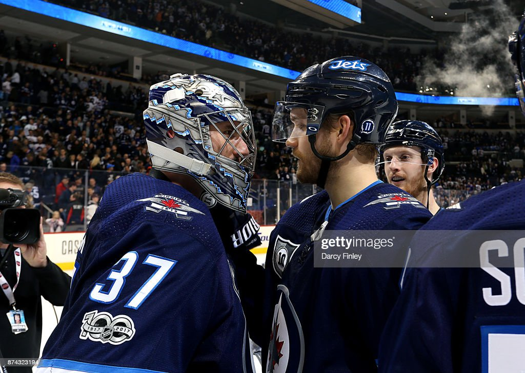 Joel Armia #40 of the Winnipeg Jets congratulates goaltender Connor Hellebuyck #37 after backstopping the Jets to a 4-1 victory over the Arizona Coyotes at the Bell MTS Place on November 14, 2017 in Winnipeg, Manitoba, Canada.