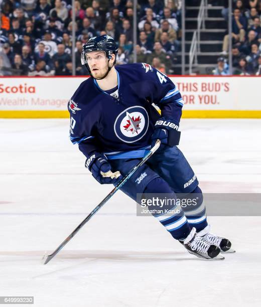 Joel Armia of the Winnipeg Jets keeps an eye on the play during first period action against the San Jose Sharks at the MTS Centre on March 6 2017 in...