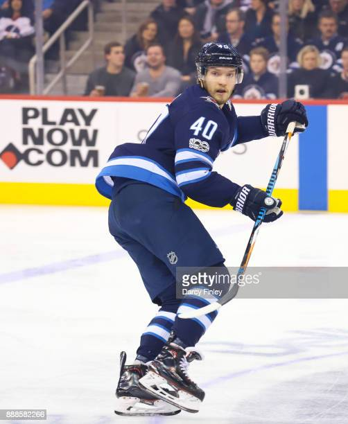 Joel Armia of the Winnipeg Jets keeps an eye on the play during first period action against the Ottawa Senators at the Bell MTS Place on December 3...