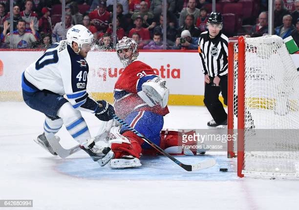Joel Armia of the Winnipeg Jets scores a goal against Carey Price of the Montreal Canadiens in the NHL game at the Bell Centre on February 18 2017 in...