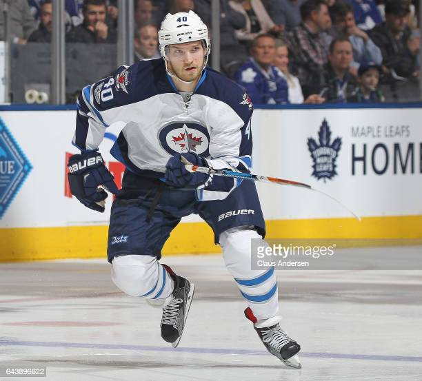 Joel Armia of the Winnipeg Jets skates against the Toronto Maple Leafs during an NHL game at Air Canada Centre on February 21 2017 in London Ontario...