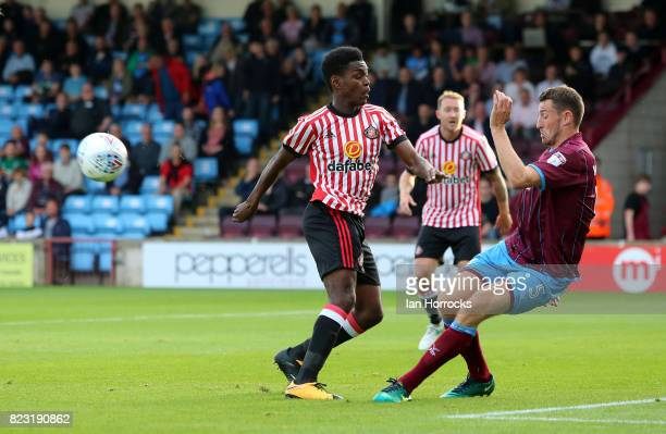 Joel Asoro of Sunderland has shot during a preseason friendly match between Scunthorpe United and Sunderland AFC at Glanford Park on July 26 2017 in...