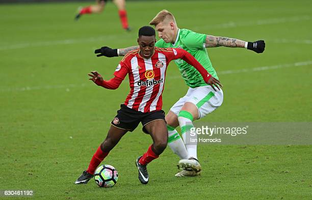 Joel Asoro of Sunderland is challenged by Jordy De Wijs of PSV during the Premier League International Cup match on December 23 2016 in Sunderland...