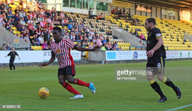 Joel Asoro of Sunderland shadowed by Scott Pittman of Livingston during a preseason friendly match between Livingston FC and Sunderland AFC at the...