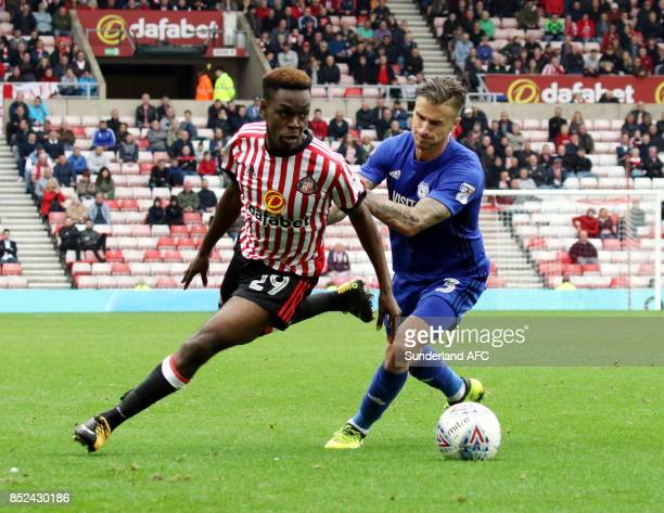 Joel Asoro of Sunderland tries to takes on Joe Bennett of Cardiff during the Sky Bet Championship match between Sunderland and Cardiff City at...