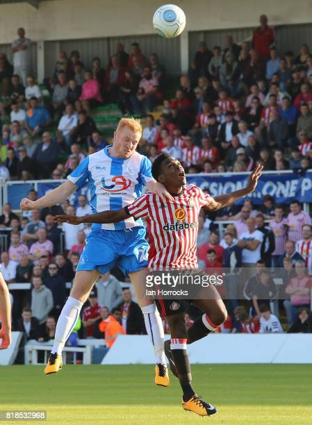Joel Asoro of Sunderland under pressure from Connor Newton of Hartlepool during the preseason friendly match between Sunderland and Hartlepool at...