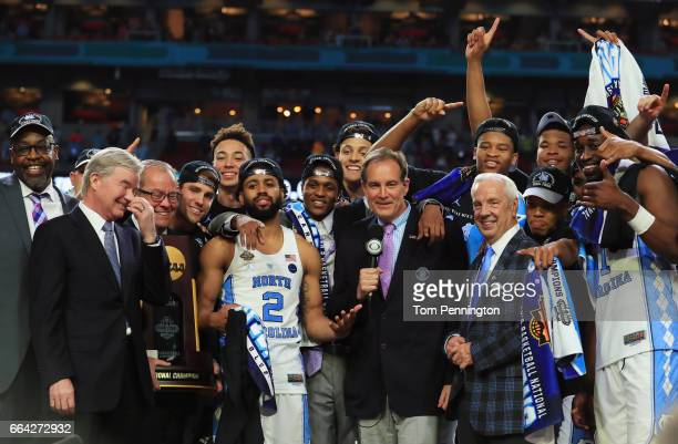 Joel Berry II and head coach Roy Williams of the North Carolina Tar Heels celebrate with their team after defeating the Gonzaga Bulldogs as NCAA...