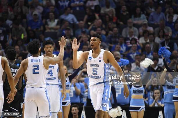 Joel Berry II and Tony Bradley of the University of North Carolina celebrate during a game against the Butler Bulldogs during the 2017 NCAA Men's...