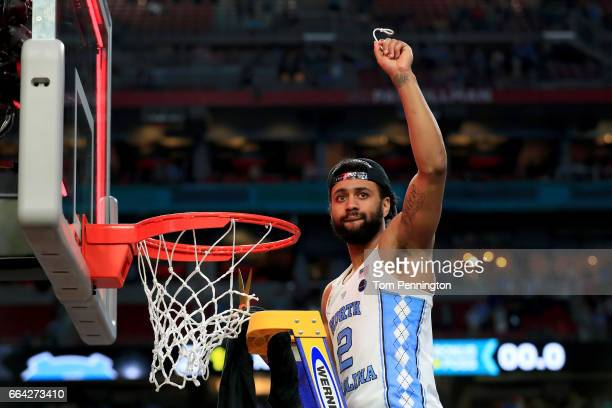 Joel Berry II of the North Carolina Tar Heels cuts the net after defeating the Gonzaga Bulldogs during the 2017 NCAA Men's Final Four National...