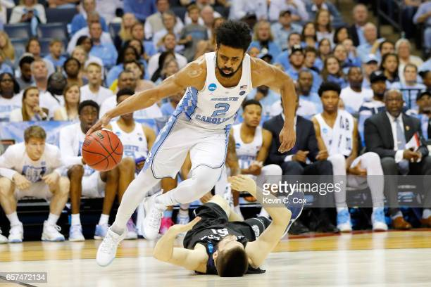 Joel Berry II of the North Carolina Tar Heels dribbles over Nate Fowler of the Butler Bulldogs in the second half during the 2017 NCAA Men's...
