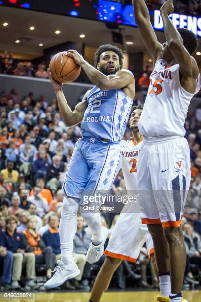 Joel Berry II of the North Carolina Tar Heels drives to the basket past Mamadi Diakite of the Virginia Cavaliers during a game at John Paul Jones...