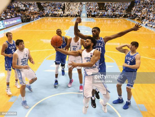 Joel Berry II of the North Carolina Tar Heels drives to the basket against Amile Jefferson of the Duke Blue Devils during their game at the Dean...