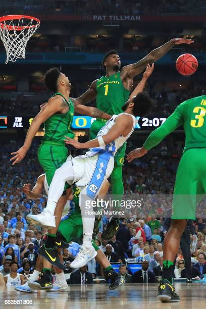Joel Berry II of the North Carolina Tar Heels goes up with the ball against Tyler Dorsey and Jordan Bell of the Oregon Ducks in the second half...