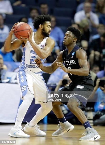 Joel Berry II of the North Carolina Tar Heels handles the ball against Kamar Baldwin of the Butler Bulldogs in the second half during the 2017 NCAA...