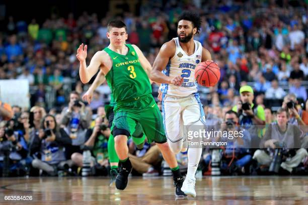 Joel Berry II of the North Carolina Tar Heels handles the ball against Payton Pritchard of the Oregon Ducks in the second half during the 2017 NCAA...