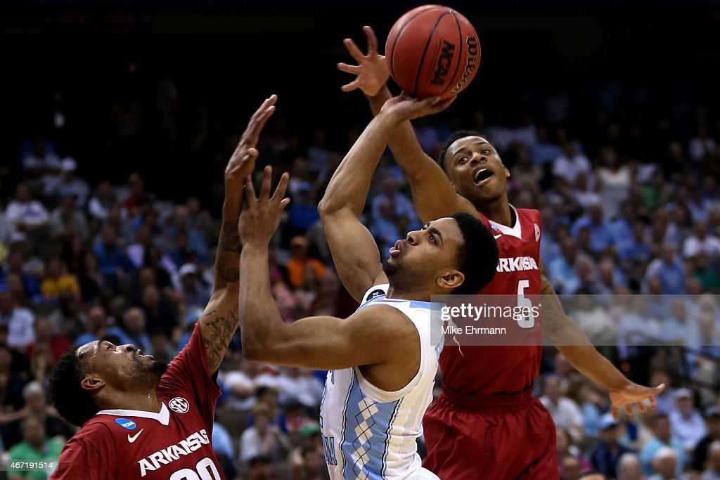 Joel Berry II of the North Carolina Tar Heels has his shot blocked by Anthlon Bell of the Arkansas Razorbacks in the first half during the third...