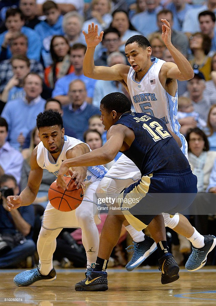 Joel Berry II #2 of the North Carolina Tar Heels knocks the ball away from Chris Jones #12 of the Pittsburgh Panthers during their game at the Dean Smith Center on February 14, 2016 in Chapel Hill, North Carolina. North Carolina won 85-64.